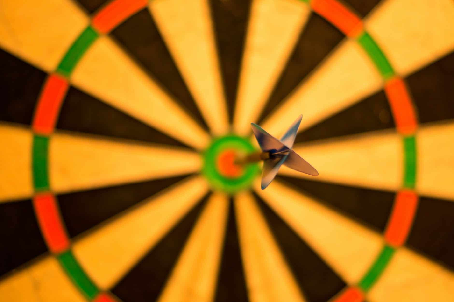black dart pink attach on yellow green and red dart board